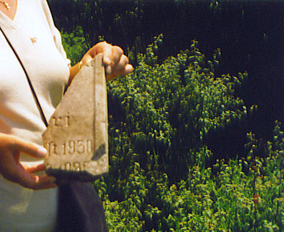 Liz holding a headstone fragment found at the SW edge of the old cemetery near the Tschesterek/Kikinda Road<br>Click to enlarge