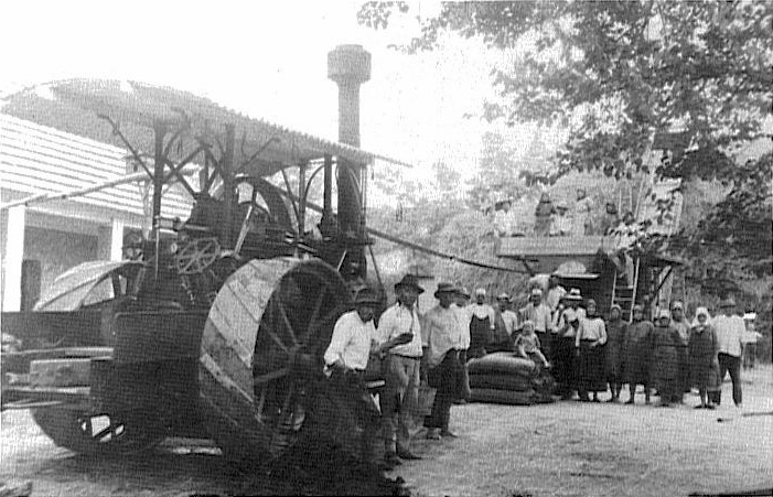 Threshing Machine with the operators Anton Lieblang, & Alexander Papp in the foreground & the threshing crew<br>Click to enlarge